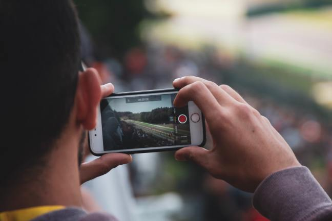 Man filming on a smart phone